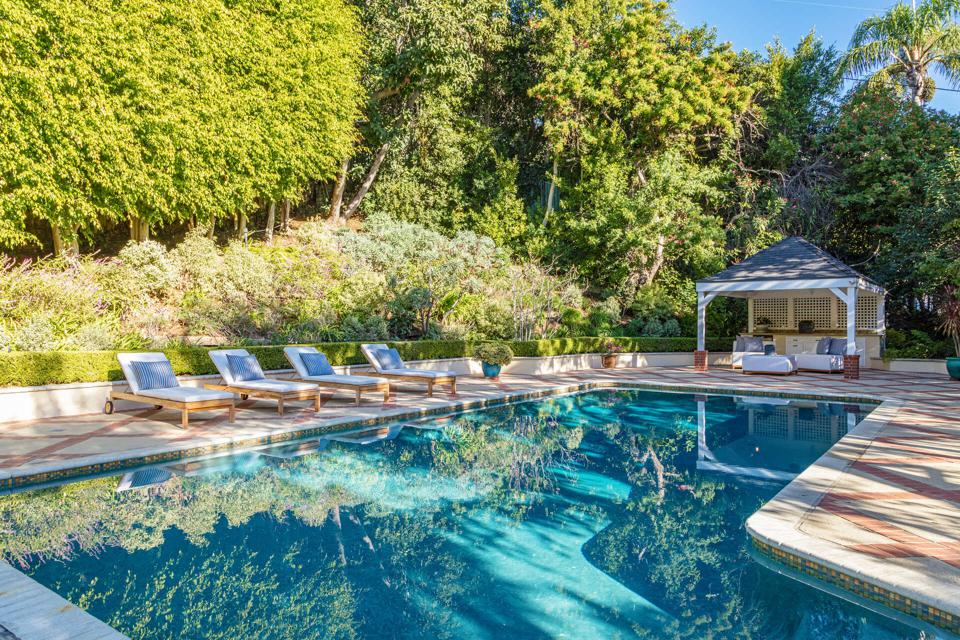 The Hollywood-style pool with an outdoor entertainment area.