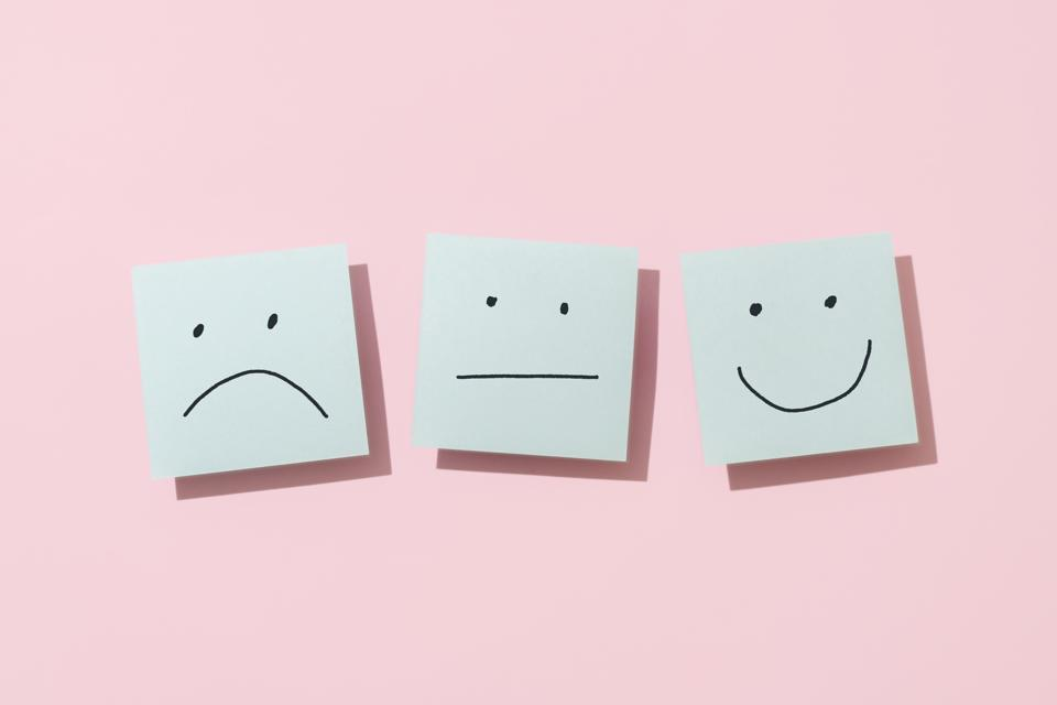 Three Blue Sticky Blank Notes On Pink Background