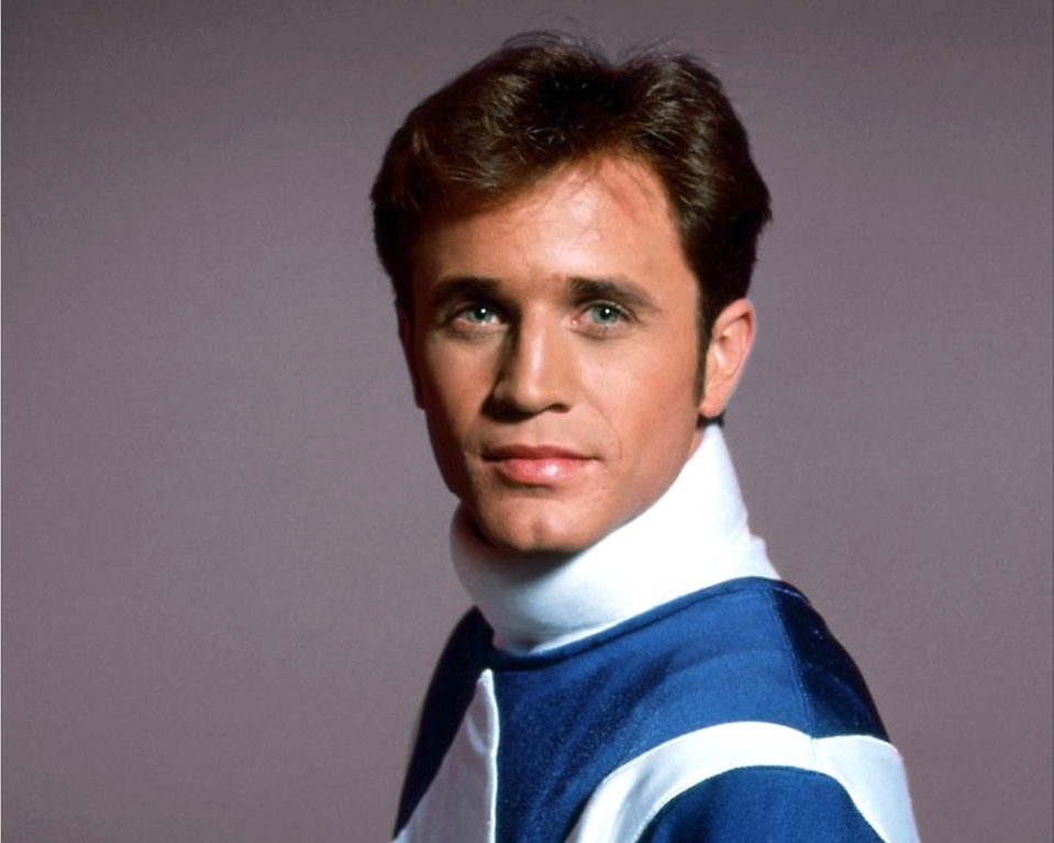 David Yost wearing his Power Rangers Blue Ranger suit in the 1990s