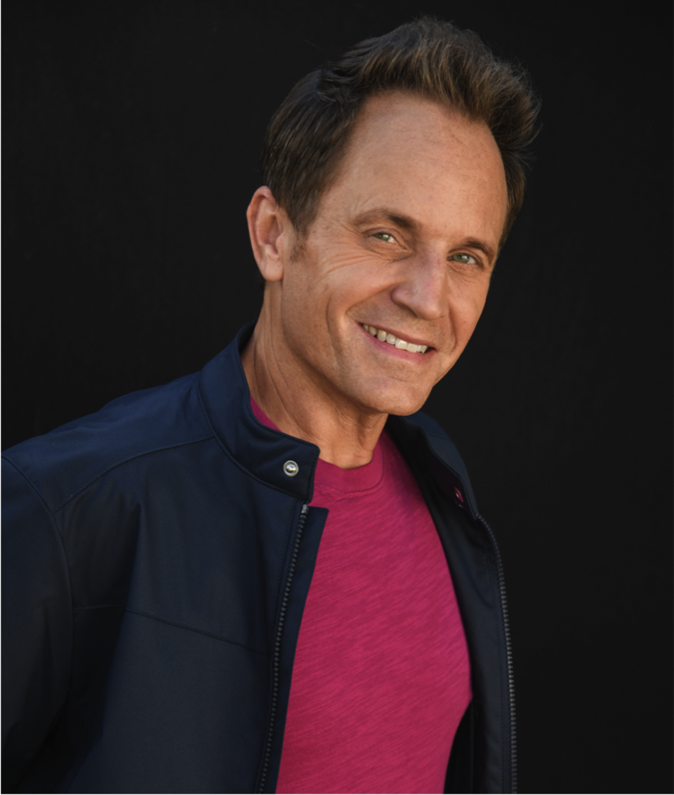 David Yost smiling and posing for a photo