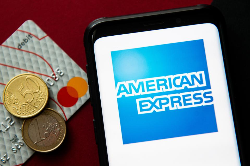 In this photo illustration a American Express logo seen...