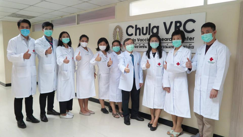 Ten male and female Thai researchers in lab coats stand in front of the Chula VRC sign