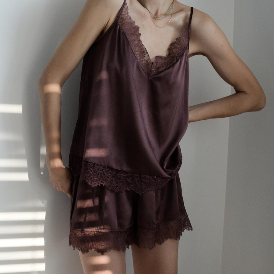 The Braylen Dusk sleepwear camisole and Ember Dusk sleepwear short are crafted from silk stretch charmeuse and accented with sheer lace details.