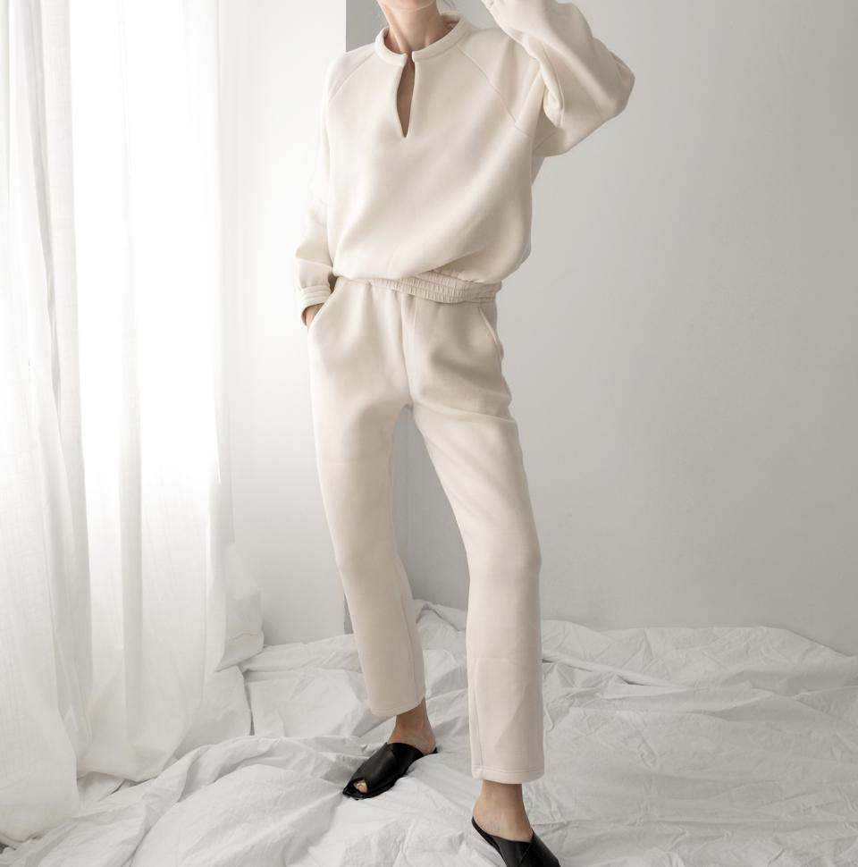 The perfect neutral sweatsuit for all seasons. This set is crafted with lush, cozy fabric derived from recycled fishnets and is accented with a flattering V-cut and cinched waistline. Your skin will stay dry and endlessly comfortable with its brushed comfort and sweat-wicking properties