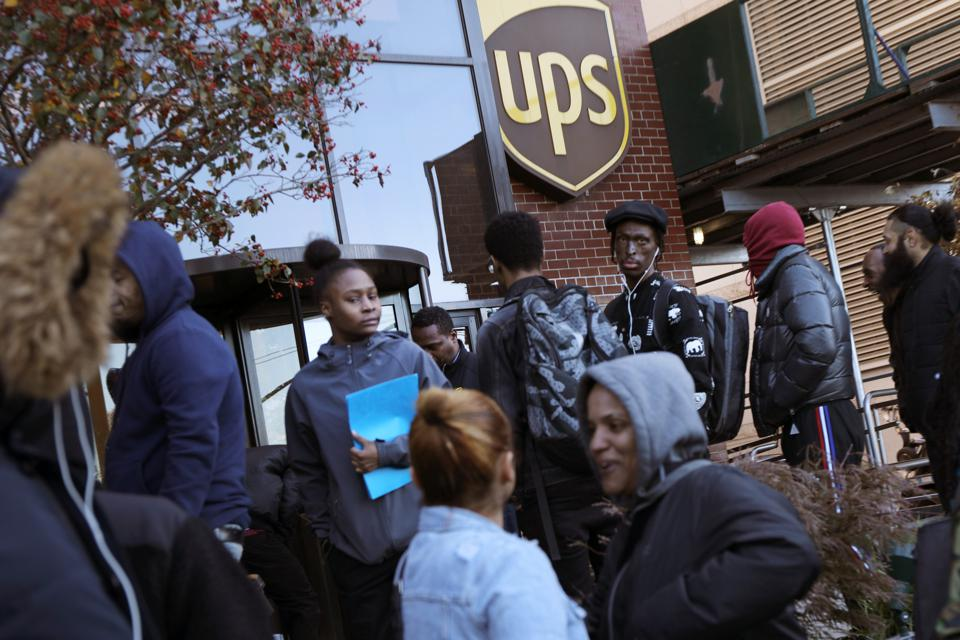 NEW YORK, NEW YORK - People wait in line for a job fair at a United Parcel Service (UPS) facility on November 01, 2019 in New York City. (Photo by Spencer Platt/Getty Images)