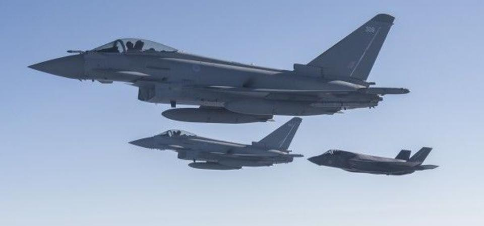 A pair of RAF Eurofighter Typhoons in formation with the F-35 by 2020.