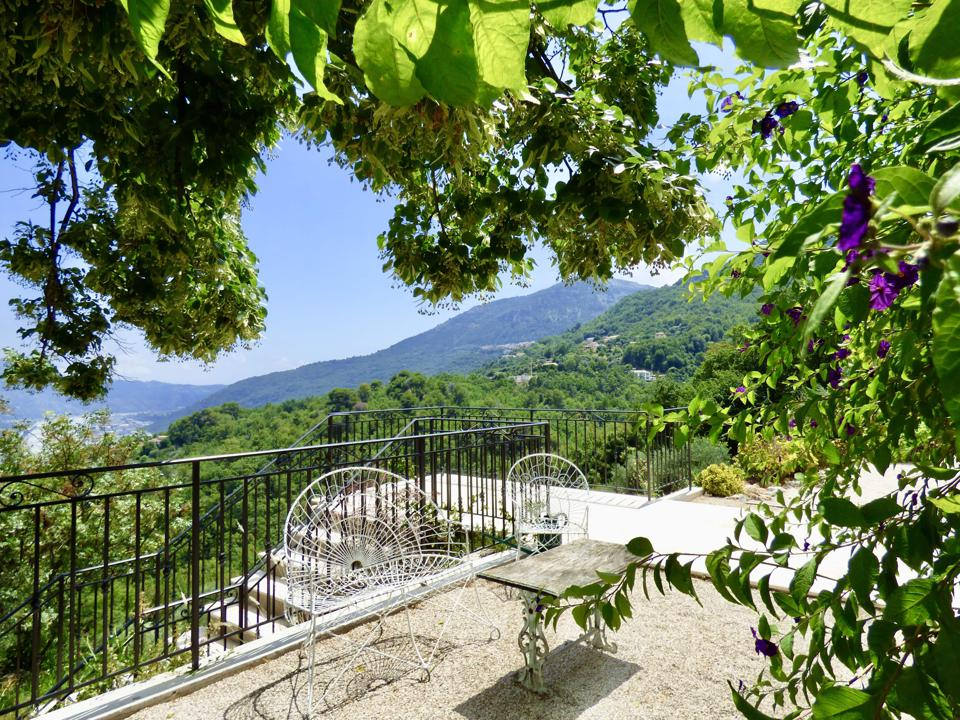 A terrace reveals views of the surrounding mountains and valley.