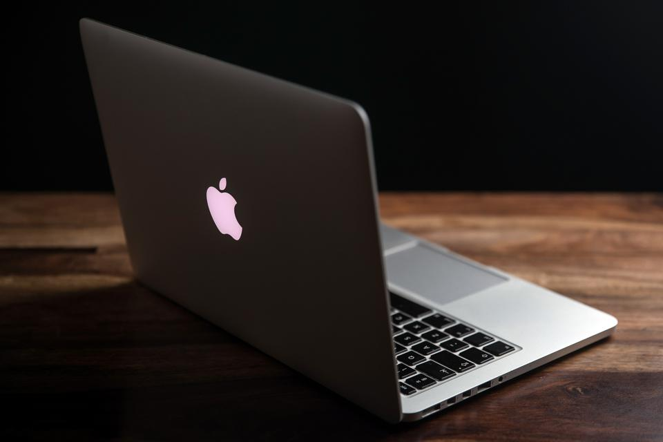 In this photo illustration a 13inch Macbook pro seen...