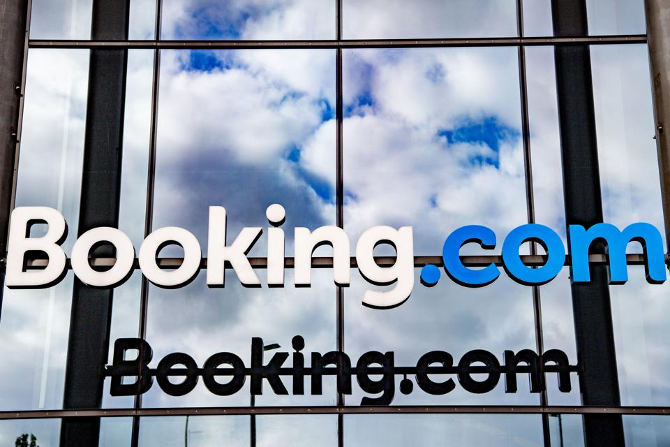 A booking.com logo displayed at the front entrance of...