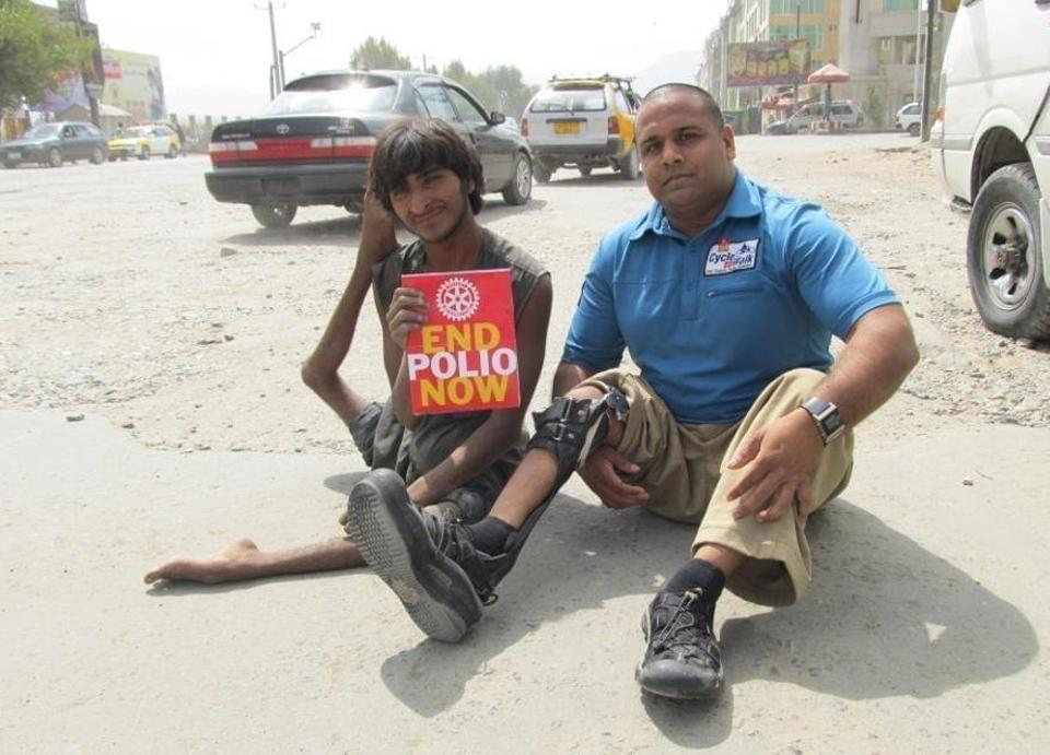 Ramesh meets with a polio survivor living on the streets of Kabul, Afghanistan