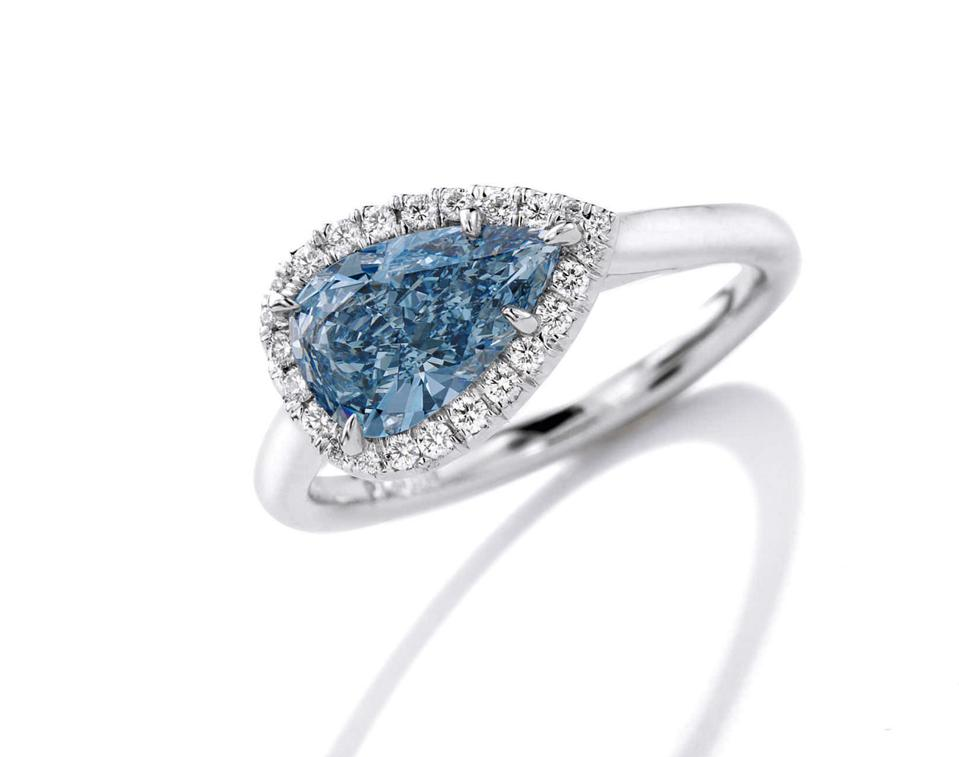 A ring set with a 1.08-carat pear-shaped fancy vivid blue diamond sold for $927,500