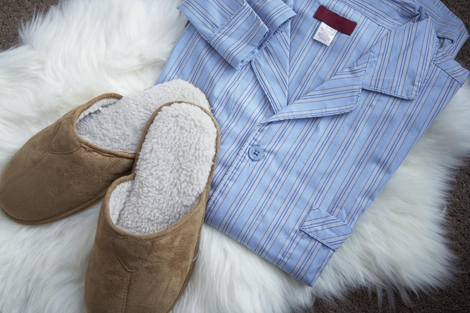 Blue pajamas and slippers on furry rug