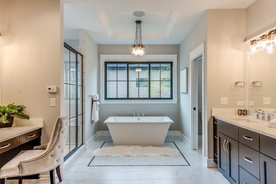 Free standing bathtub and sink cabinetry