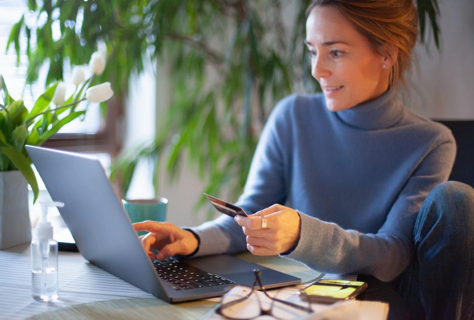 Woman using credit card for online shopping