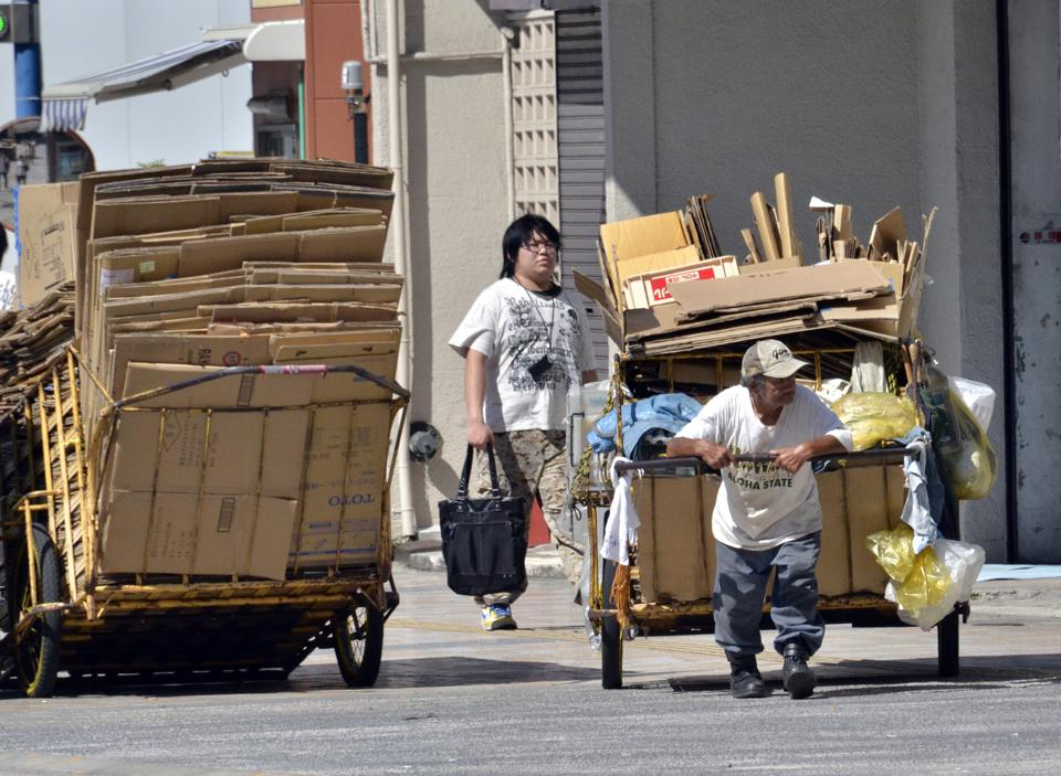 A man pulls a cart transporting cardboard, to sell to a recycling plant, in Tokyo on August 30, 2011.  The Japanese economy required a major turnaround following the banking crisis of 2008 and Eurozone crisis of 2011.