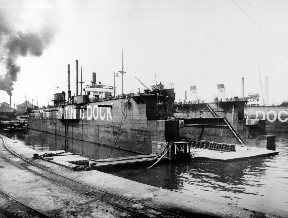 Japan saw a rapid industrialization led by large family business groups following the restoration of the Emperor in 1867.  Seen here Japan's Kawasaki shipyards in 1930.