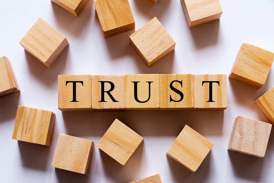 'TRUST' Word on Wooden Blocks. Business concept