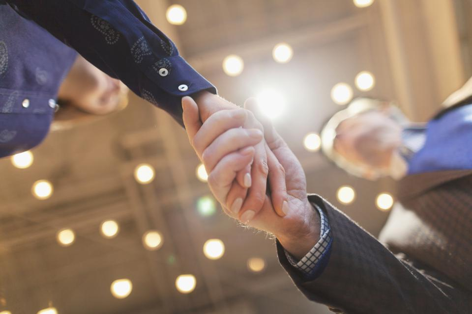 Man and woman shaking hands in design office