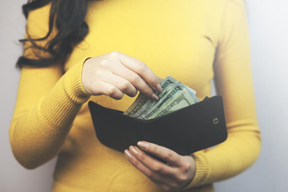 woman hand wallet and money
