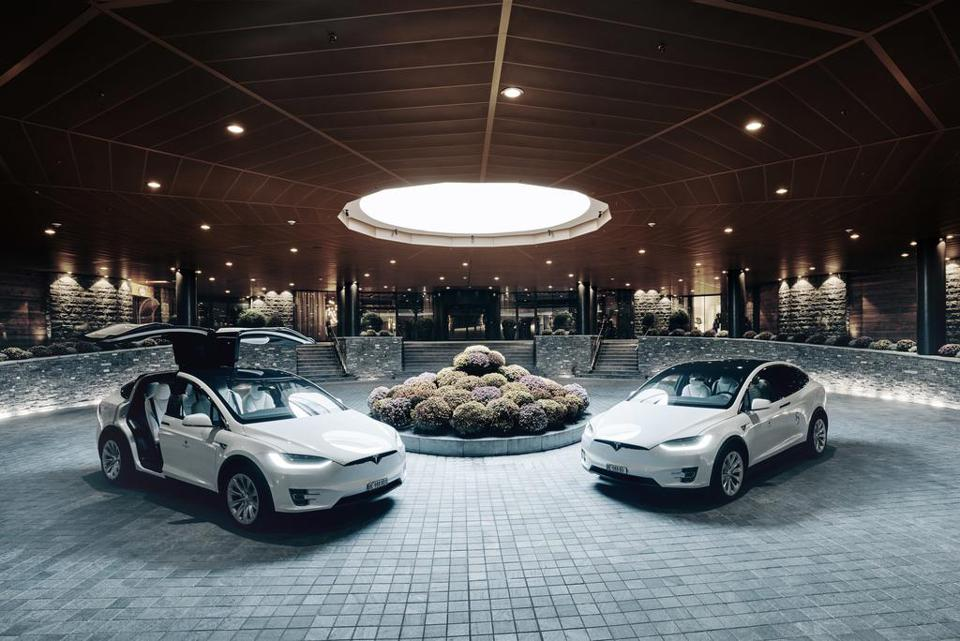 The Alpina Gstaad's Tesla shuttles in front of the luxury hotel's entrance