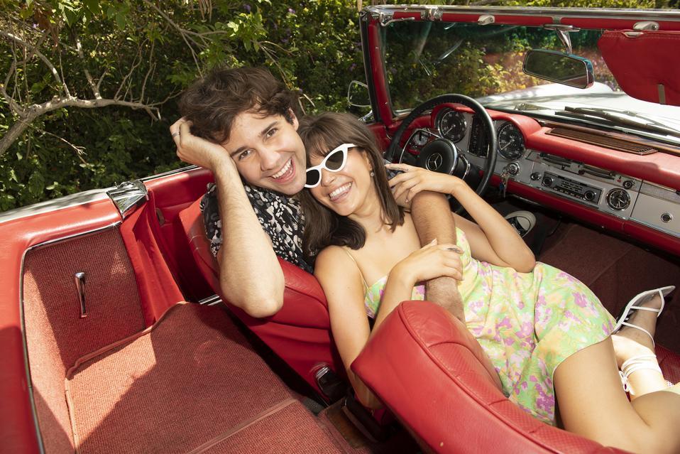 David Dobrik and lady friend in a car. #DavidsPerfume
