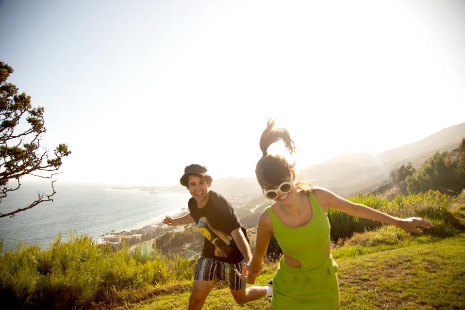 David Dobrik and lady friend running on cliffs overlooking the sea. #DavidsPerfume