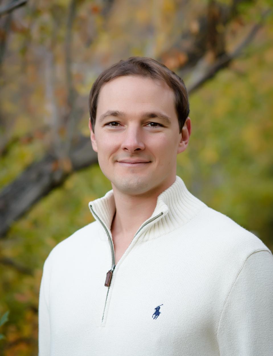 Portrait of a man wearing white Ralph Lauren Polo sweater