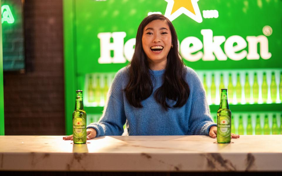Actress Awkwafina (Nora Lum) celebrates the holidays with a couple of Heineken beers.