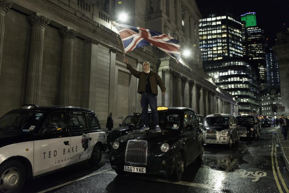 John McDonnell, taxi driver waiving an UK flag on top of a...