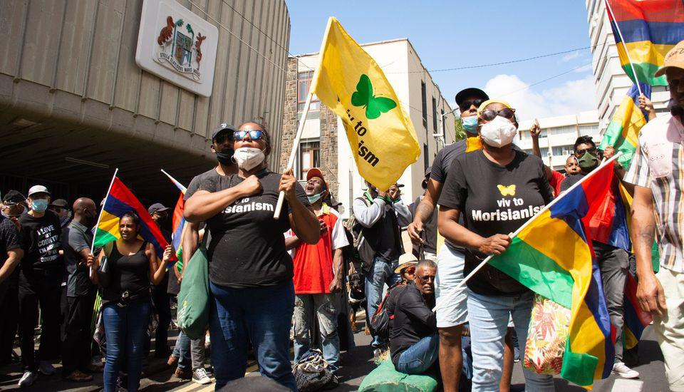There have been protests outside Mauritius' parliament at how the oil spill response has been handled