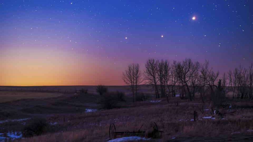 The trio of (L to R) Saturn, Mars and Jupiter in conjunction in the dawn twilight, taken in Alberta on March 26, 2020.