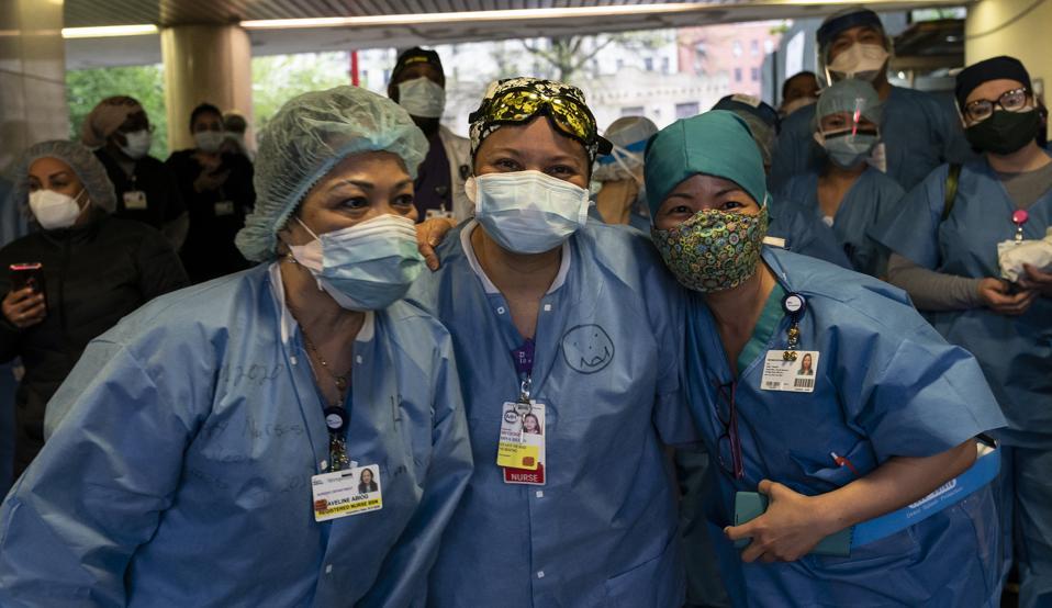 Nurses, doctors, medical staff seen during Mayor de Blasio...