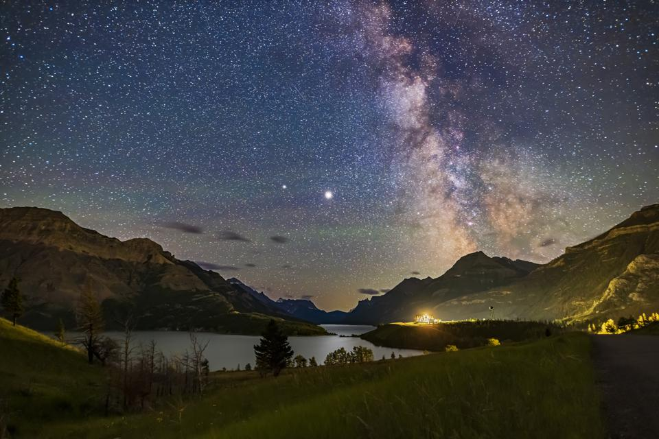 The galactic core area of the Milky Way over Waterton Lakes National Park, Alberta with the pairing of giant planets from summer 2020. Jupiter is the bright object at centre, with Saturn dimmer to the left (east) of Jupiter. In 2020 the two planets were c