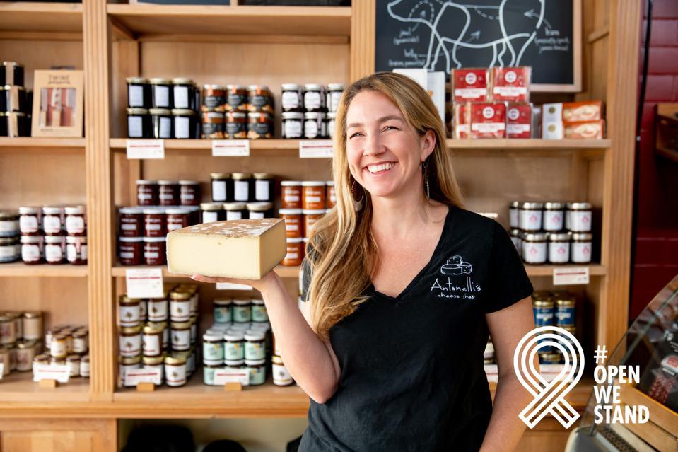 Kendall Antonelli, a GoDaddy domain/hosting customer & president of Antonelli's Cheese Shop