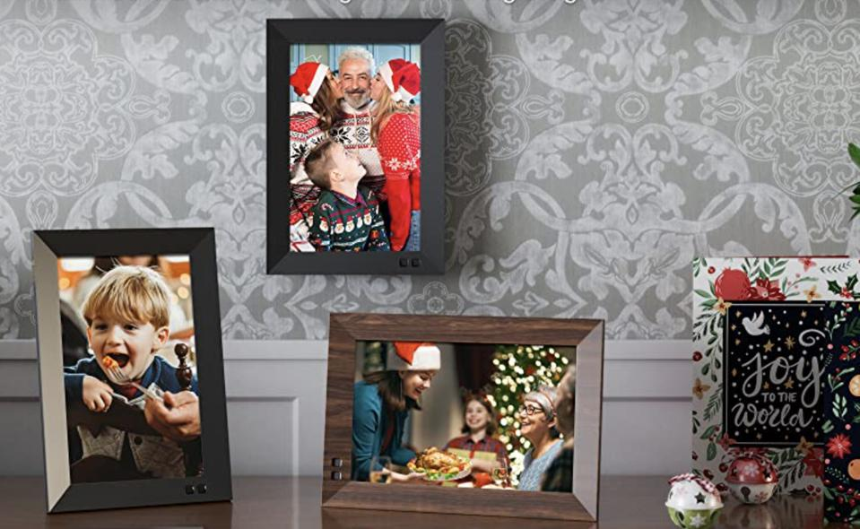 Digital frames set up on table and on a wall