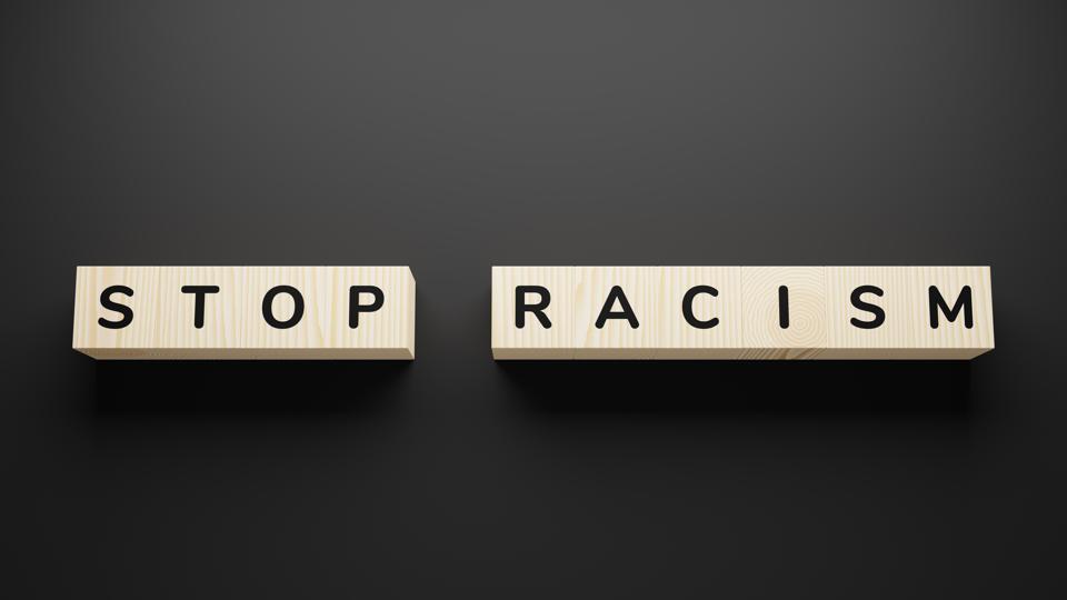 Stop racism quote written in wooden blocks.