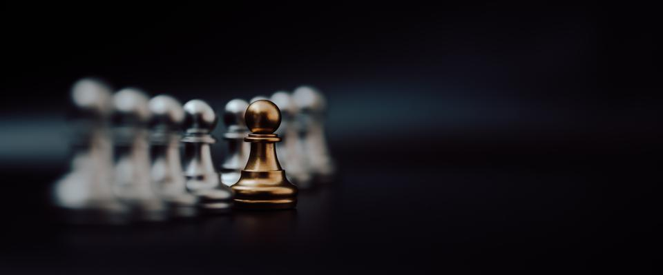 racial equity symbolized by gold pawn of chess.