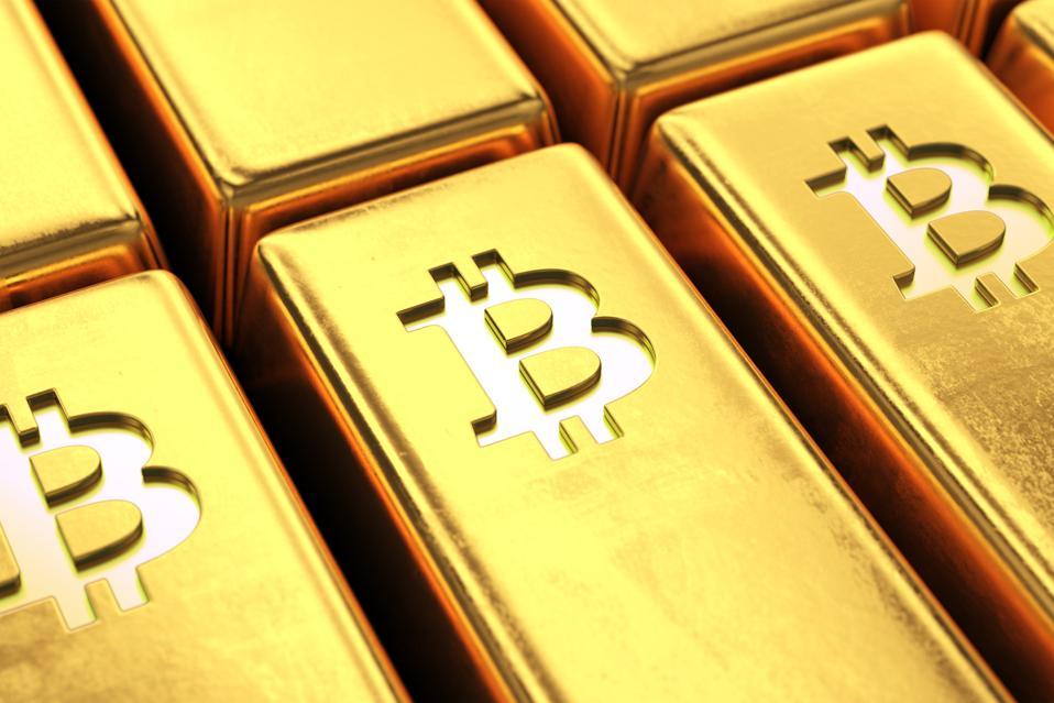 Gold bars with bitcoin symbol close up