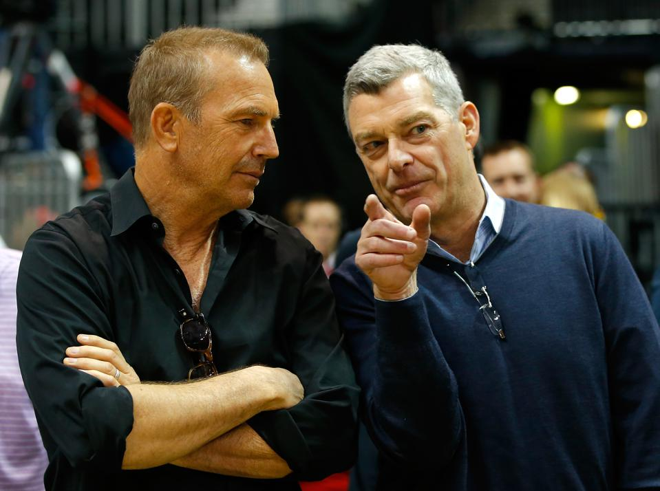 Tony Ressler (r) chats with actor Kevin Costner @ Cleveland Cavaliers v Atlanta Hawks