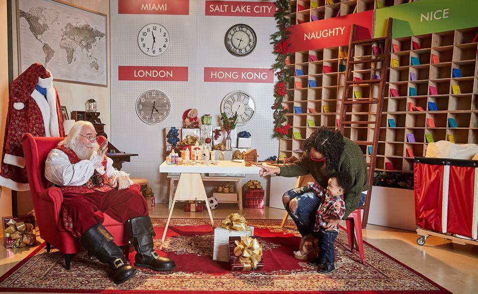 A boy greeting Santa Claus.