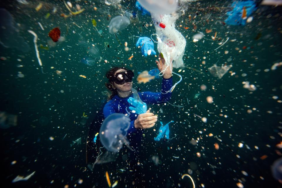 World record-holding free-diver Şahika Ercümen dives amid plastic waste in the Bosphorus.