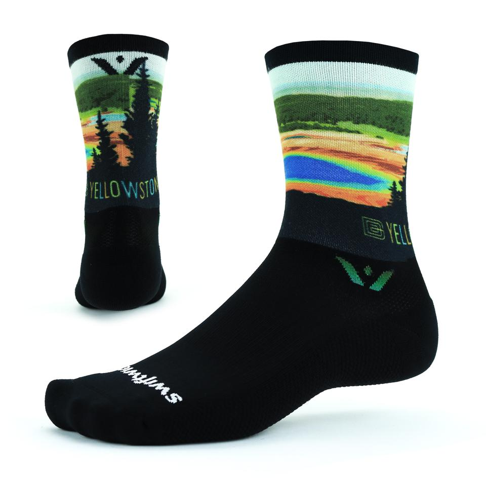 Socks emblazoned with art depicting Yellowstone National Park.