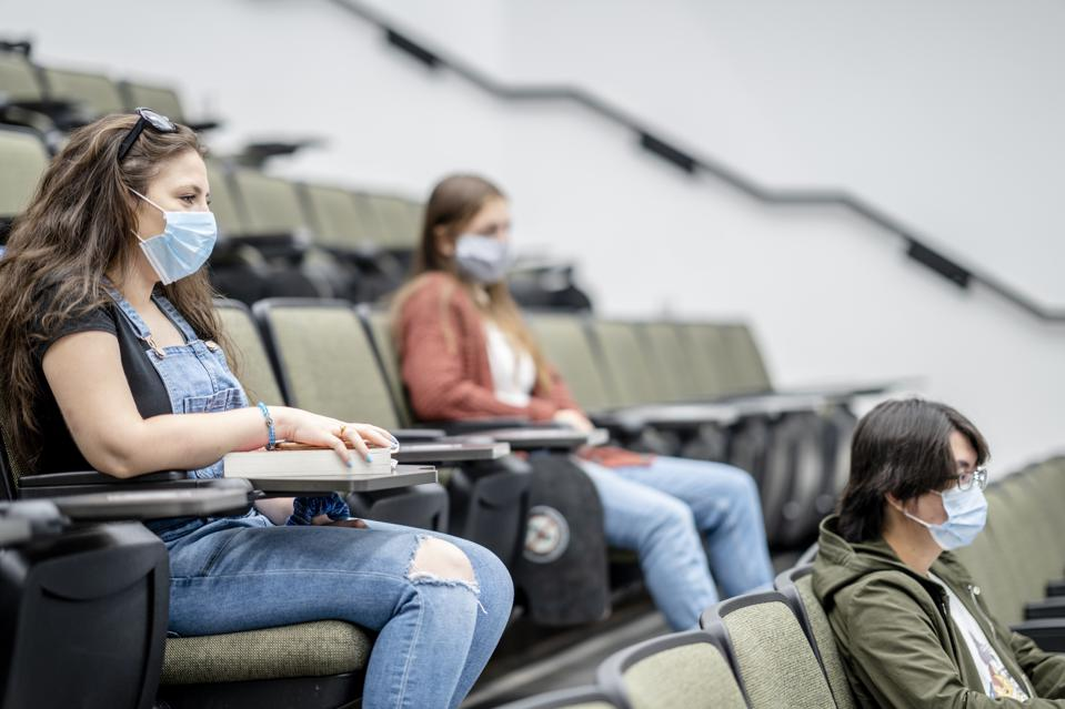 Group of university students wearing masks in class