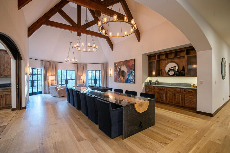 A 16-foot custom table seats 12 and features a pine tree from the 20-acre grounds.