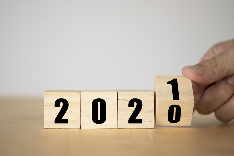 Hand flipping wooden blocks for change year  2020 to 2021.