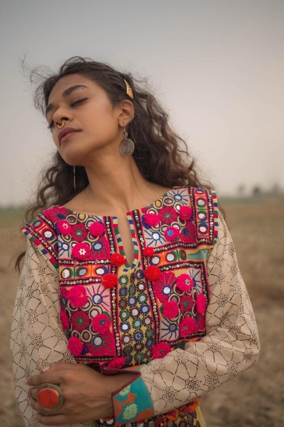 A model wears a meenakari tunic by Aman Kay Rang.