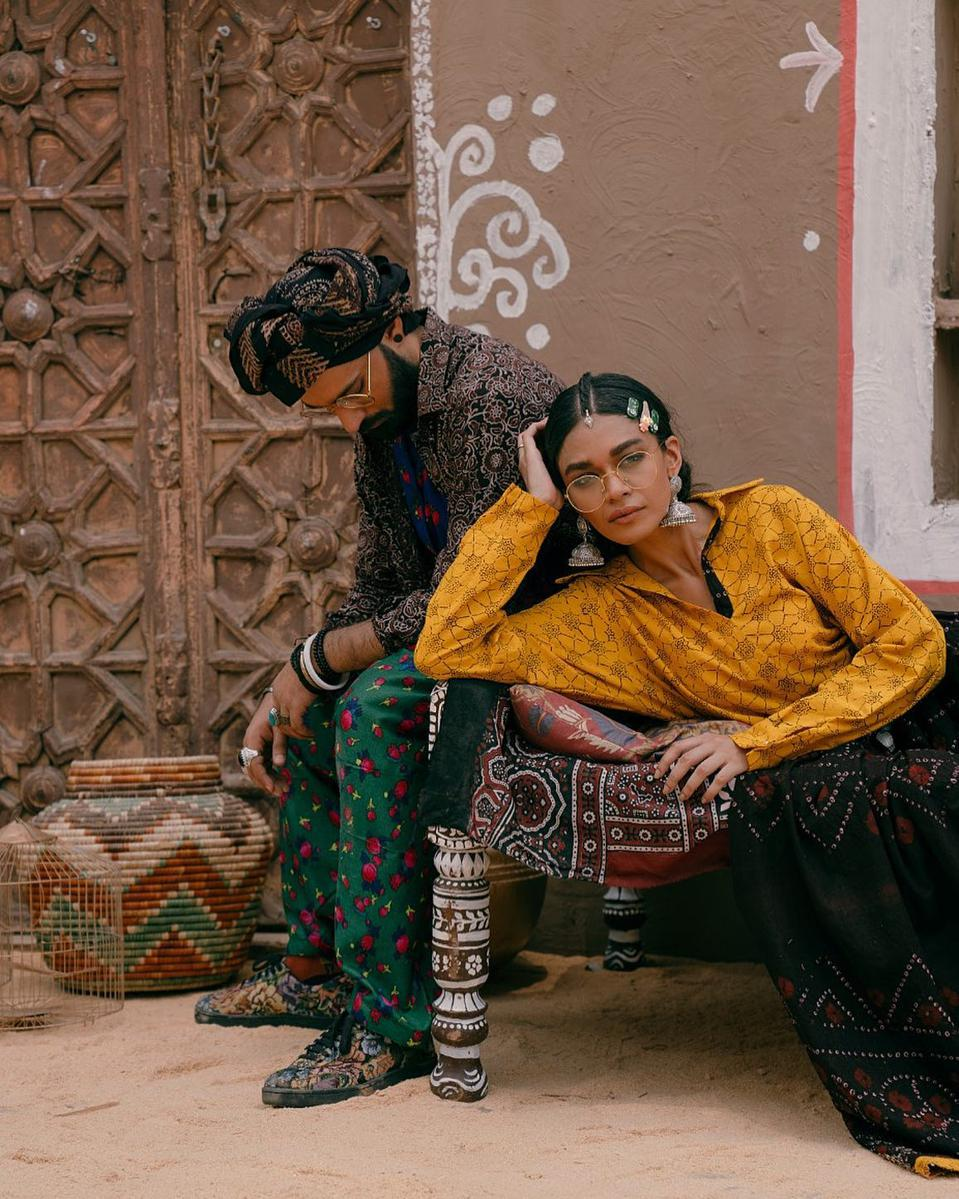 Models wear Aman Kay Rang ensembles.
