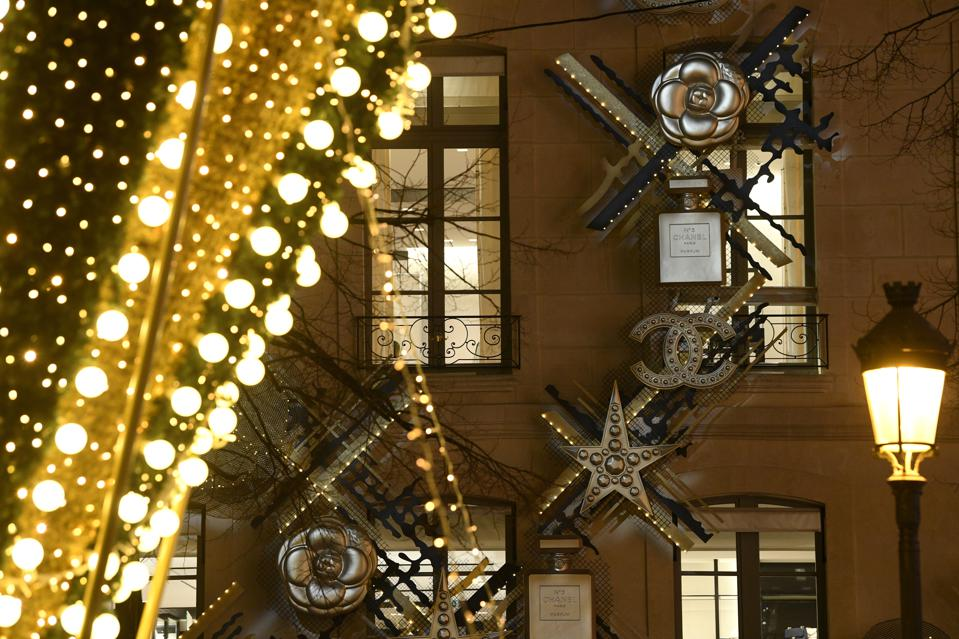 Christmas Lights And Decorations Are Displayed At The Chanel Boutiques In Paris
