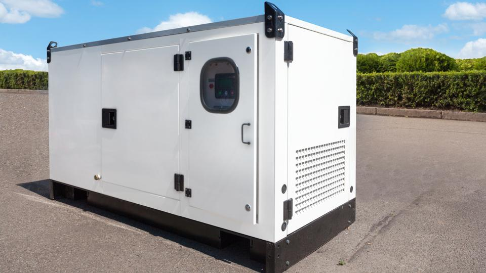 Industrial Diesel Generator for Office Building connected to the Control Panel with Cable Wire.