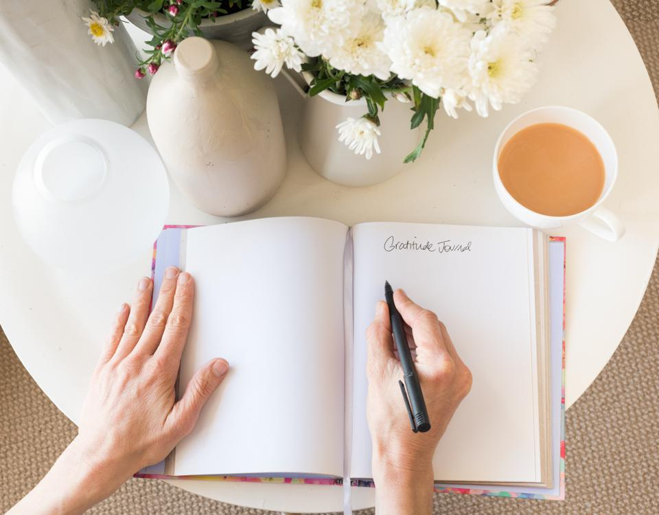 Woman's hands with gratitude journal